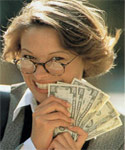 Happy business woman holding money