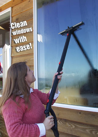 Woman cleaning windows steam cleaner